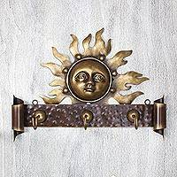 Iron coat rack, 'Curious Sun' - Artisan Crafted Sunny Coat and Key Holder