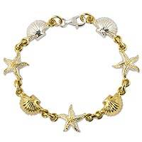 Gold accented charm bracelet, 'Treasures of the Sea' - Gold Plated Ocean Theme Charm Bracelet