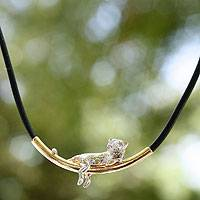 Gold accented sterling silver pendant necklace, 'Silver Ocelot' - Ancient Cat 22k Gold Plated Sterling Silver Necklace