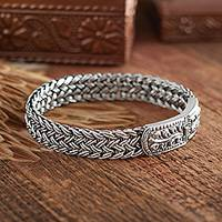 Sterling silver wristband bracelet, 'Unity' - Unique Braided Sterling Silver Bracelet