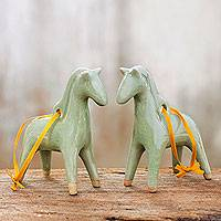 Celadon ceramic ornaments, 'A Season for Horses' (pair) - Unique Celadon Ceramic Christmas Ornaments (Pair)
