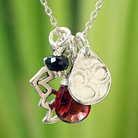 Garnet and onyx flower necklace, 'Lotus Om' - Hand Made Sterling Silver and Garnet Pendant Necklace