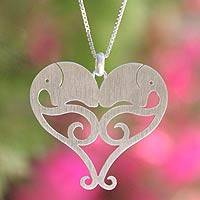 Sterling silver heart necklace, 'Elephant Sweethearts' - Hand Made Sterling Silver Pendant Necklace