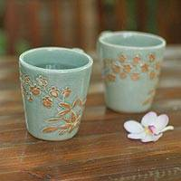 Celadon ceramic coffee mugs, 'Golden Orchid' (pair) - Unique Floral Ceramic Coffee Mugs (Pair)