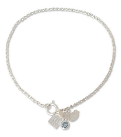 Sterling Silver and Blue Topaz Charm Bracelet