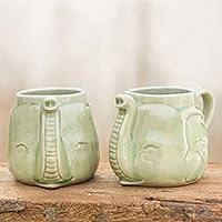 Celadon ceramic mugs, 'Elephant Greeting' (pair) - Celadon Ceramic Mugs (Pair)
