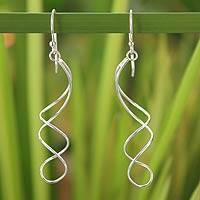 Sterling silver dangle earrings, 'Gentle Sigh' - Handcrafted Modern Sterling Silver Dangle Earrings