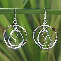 Sterling silver dangle earrings, 'Twirling' - Handmade Sterling Silver Dangle Earrings