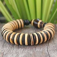 Coconut shell and wood stretch bracelet, 'Forest Moods' - Coconut shell and wood stretch bracelet