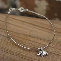 Silver charm bracelet, 'Moonlit Elephant' - Fair Trade Fine Silver Charm Bracelet
