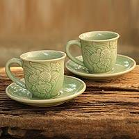 Celadon ceramic cups and saucers, 'Jade Orchids' (set for 2) - Celadon Ceramic Cups and Saucers (pair)