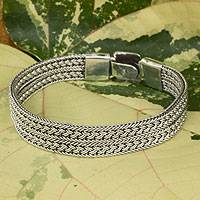Men's sterling silver bracelet, 'Distinction' - Men's Wide Sterling Silver Braided Bracelet Thailand