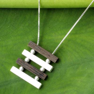Sterling silver and wood pendant necklace, 'Nature's Balance' - Artisan Crafted Necklace Sterling Silver and Wood