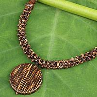Coconut shell and wood beaded necklace, 'Precious Nature' - Beaded Coconut Shell And Wood Medallion Necklace