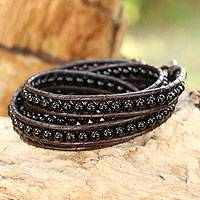 Onyx wrap bracelet, 'Black Sun' - Hand Knotted Onyx and Leather Wrap Bracelet from Thailand