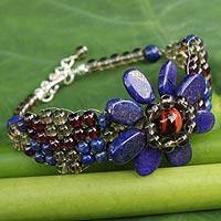 Lapis lazuli and garnet beaded bracelet, 'Floral Solitaire' - Beaded Garnet and Lapis Lazuli Flower Bracelet