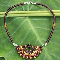 Tiger's eye and carnelian pendant necklace, 'Star of Nan' - Crocheted Tiger's Eye Necklace Artisan Crafted Jewelry