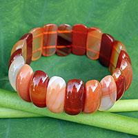 Carnelian stretch bracelet, 'Just Glow' - Fair Trade Beaded Carnelian Stretch Bracelet from Thailand