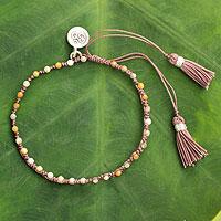 Jasper beaded bracelet, 'Sunlit Om' - Hand-knotted Jasper Beaded Bracelet with Silver charm