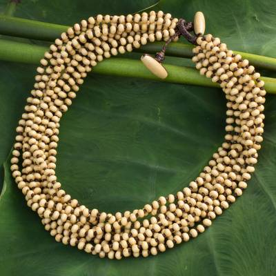 Wood torsade necklace, 'Natural Belle' - Fair Trade Artisan Crafted Wood Torsade Necklace