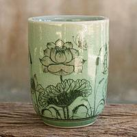 Celadon ceramic teacup, 'Pink Lotus Butterflies' - Thai Celadon Handleless Floral Teacup