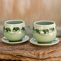 Celadon ceramic teacups and saucers, 'Prancing Elephants' (pair) - Green Celadon Elephant Teacups and Saucers (Set for 2)