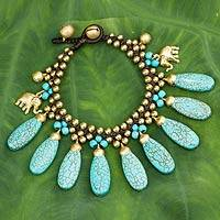 Brass charm bracelet, 'Siam Legacy II' - Brass Beaded Turquoise Colored Elephant Bracelet