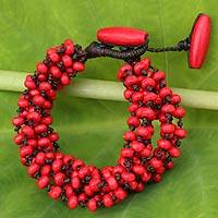 Wood beaded bracelet, 'Opulent Red' - Red Hand Knotted Beaded Bracelet