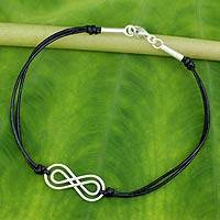 Leather pendant bracelet, 'Infinite Friendship' - Sterling Silver and Black Leather Bracelet from Thailand