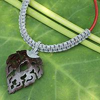 Leather and coconut shell flower necklace, 'Fire Leaf in Grey' - Fair Trade Leather Necklace with Leaf Shape Pendant