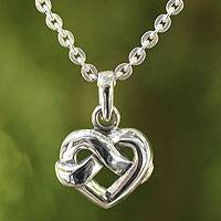 Sterling silver pendant necklace, 'With Love' - Heart Shaped Knot Sterling Silver Pendant Necklace