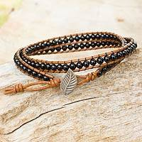 Quartz and leather wrap bracelet, 'Hill Tribe Black' - Onyx and Leather Wrap Bracelet with Hill Tribe Silver Leaf