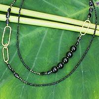 Gold plated onyx beaded necklace, 'Precious Black' - Artisan Crafted Gold Plate and Onyx Wrap Beaded Necklace