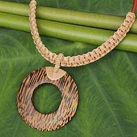 Coconut wood pendant necklace, 'Coconut Ring in Beige' - Handmade Beige Macrame and Coconut Shell Necklace