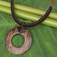 Coconut wood pendant necklace, 'Coconut Ring in Brown' - Handcrafted Coconut Wood Necklace on Brown Macrame