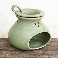 Celadon ceramic oil warmer, 'In Harmony' - Green Celadon Ceramic Oil Warmer from Thailand