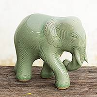 Celadon ceramic figurine, 'Purposeful Elephant' - Celadon Ceramic Elephant Figurine by Thai Artisans