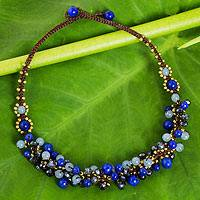 Beaded necklace, 'Blue Cattlelaya' - Blue Quartz and Brass Clusters on Hand Knotted Necklace