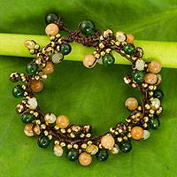 Beaded bracelet, 'Tropical Cattlelaya' - Artisan Hand Knotted Green Yellow Beaded Bracelet