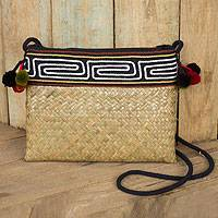 Natural fibers with cotton accent shoulder bag, 'Akha Wonder' - Hand Woven Natural Fiber Shoulder Bag with Thai Pompoms