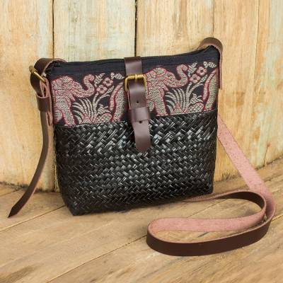 Natural fibers with leather accent shoulder bag, 'Thai Elephant Parade on Black' - Black Sedge Shoulder Bag with Brown Leather Accents