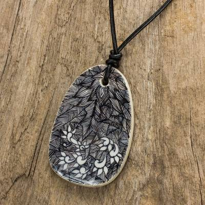 Leather and ceramic pendant necklace, 'Jungle Maze' - Artisan Crafted Black and White Ceramic Pendant Necklace