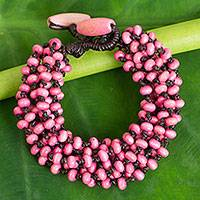 Wood torsade bracelet, 'Kok Belle' - Pastel Pink Torsade Bracelet Wood Beaded Jewelry