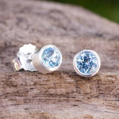 Blue topaz stud earrings, 'Light' - Sterling Silver Stud Earrings with Faceted Blue Topaz