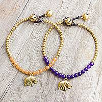 Beaded bracelets, 'Stylish Elephants' (pair) - Elephant Theme Brass Bracelets with Orange and Violet Gems