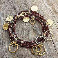 Gold plated garnet wrap bracelet, 'Fabulous Femme' - Garnet Wrap Bracelet with Gold Plated Charms