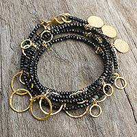 Gold plated onyx wrap bracelet, 'Fabulous Femme' - Onyx Wrap Bracelet with Gold Plated Charms from Thailand