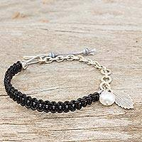 Leather and cultured pearl braided bracelet,