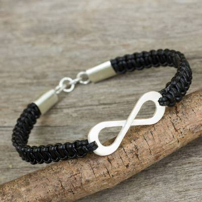 Leather and sterling silver bracelet, 'Infinite Joy in Black' - Black Leather Macrame Bracelet with Silver Infinity Pendant