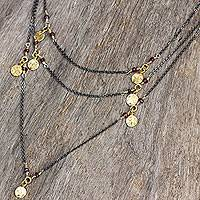 Gold accent garnet wrap necklace, 'Urban Grandeur' - Sterling Silver Wrap Necklace with Garnet and Gold Accents